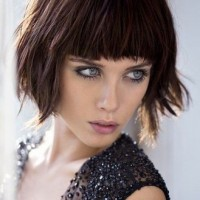 The Shaggy Wavy Bob Haircut with Rounded Full Blunt Bangs