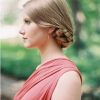 The Sleek Low Bun Hairstyle with Braid for Blond Straight Hair