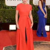 Golden Globe Style - Emma Watson's orange-red Dior couture dress over skinny navy cigarette pants