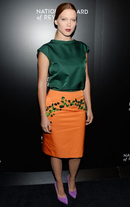 Léa Seydoux Prada silky architectural-collared top in emerald green for jewel-tone spring outfit ideas