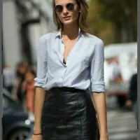 Black leather below-the-knee skirt and button down shirt