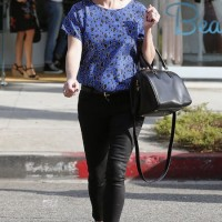 Reese Witherspoon's Silky Leopard-Print Blouse with a Pair of Edgy Waxed Jeans for Weekend Outfit Idea
