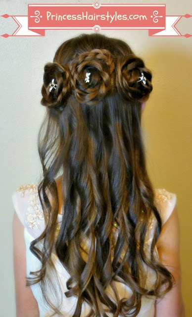A Cute Hairstyle Featuring Braids And Curls