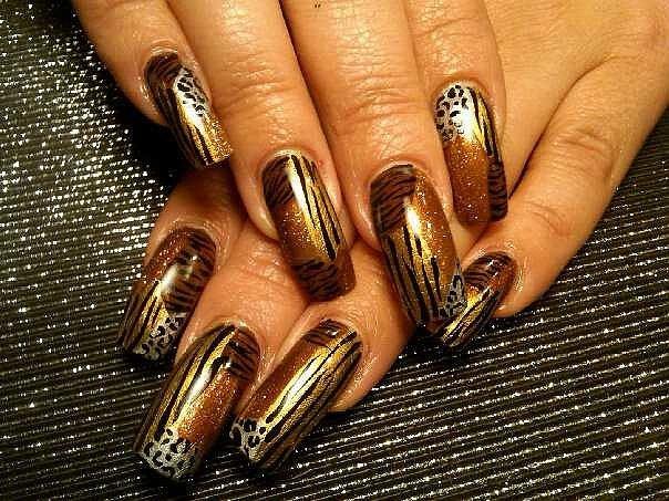 gold animal print nail art design