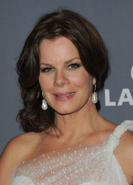Marcia Gay Harden Low Bun and Pearl Earrings