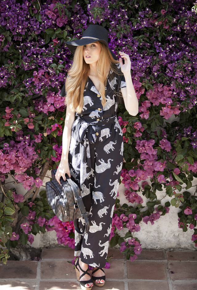 Printed Jumpsuit Outfit Idea with a Black Hat