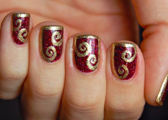 Burgundy Nail Design With Gold Swirl