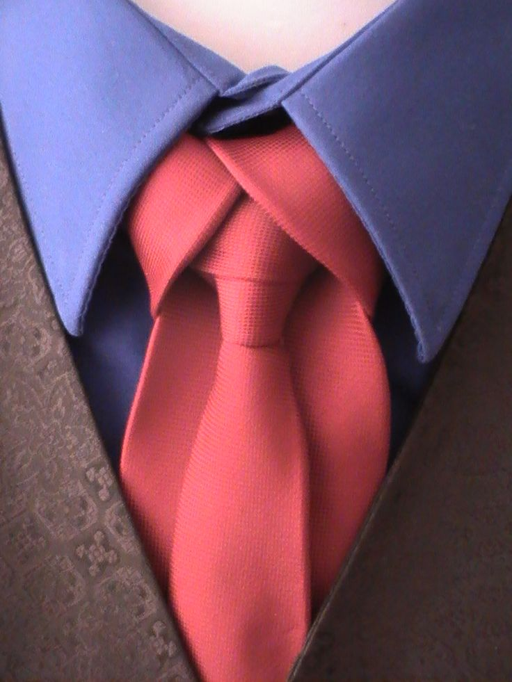 Red Tie against Blue Shirt
