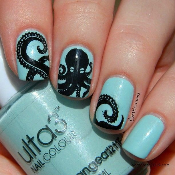 Baby Blue Colored Nails With Tribal Prints
