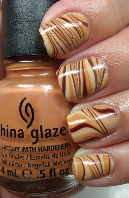 Chocolate Nail Design With Marble Prints