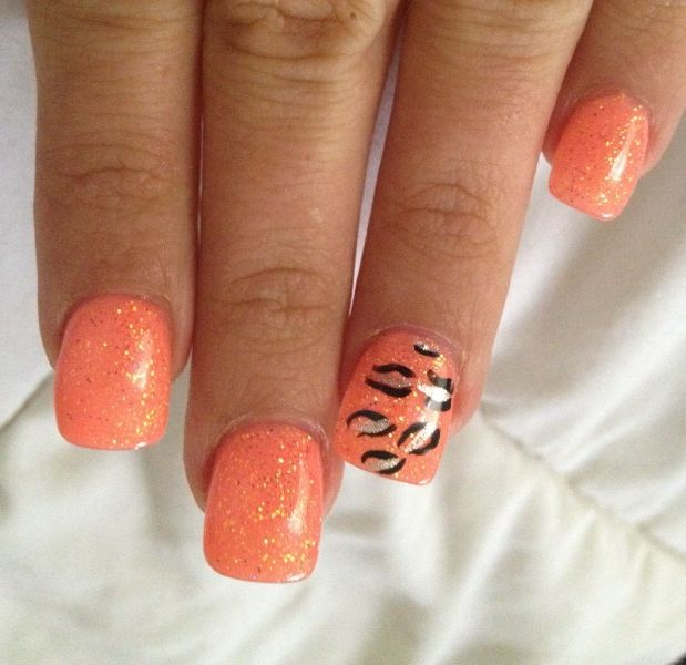 orange nail design with leopard prints