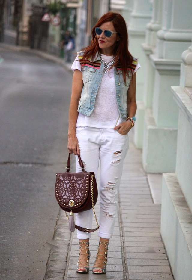 White Ripped Jeans Outfit Idea with Denim Vest