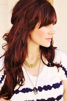 Dark Red Wavy Hairstyle With Blunt Bangs