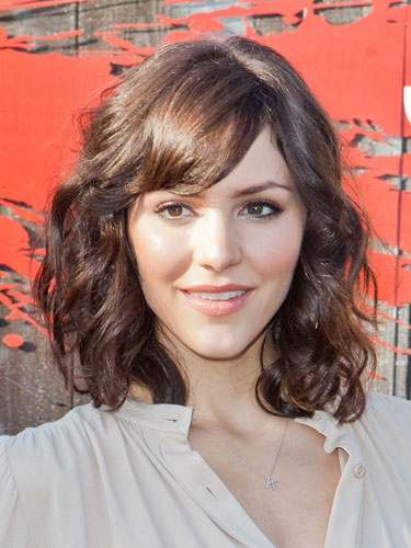 Medium Curly Wavy Hairstyle With Bangs