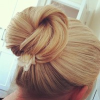 Lovely Sleek Updo Hairstyle with A Flower