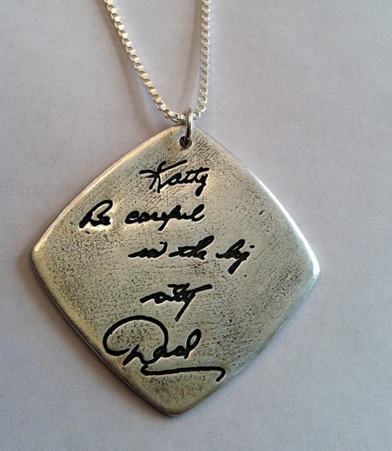A pendant with an engraved message in Your Handwriting