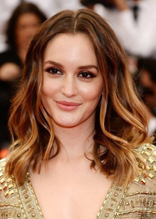 Center-parted Medium Curly Hairstyle