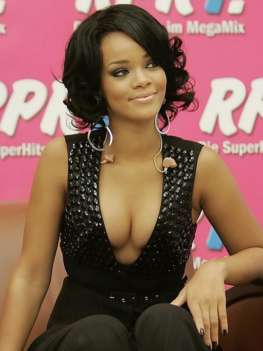 Rihanna Short Layered Black Curly Hairstyle for Black Women
