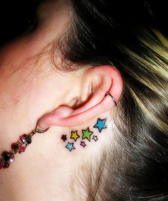 Colorful Star Tattoos behind Ears
