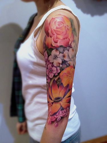 10 best flower tattoos for your arms pretty designs for Flower tattoo arm