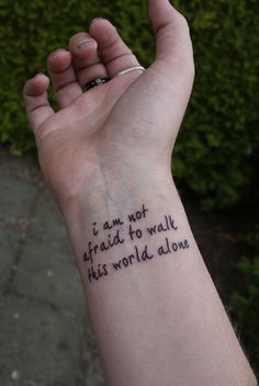 "Tattoo Designs For Girls ""I Am Not Afraid To Walk This World Alone"