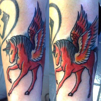 Beth Lucas tattoos – red unicorn by Ash Against
