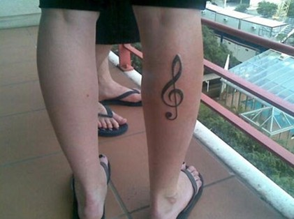 Beth Lucas tattoos – treble clef music symbol right leg