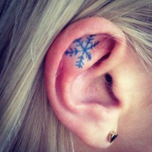 Snowflake Inner Ear Tattoo