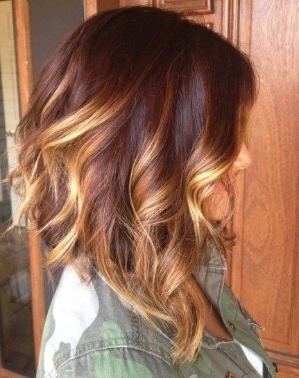 Medium Layered Hairstyle with Blond Highlights
