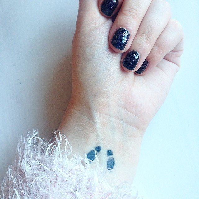 Footprints tattoo for women