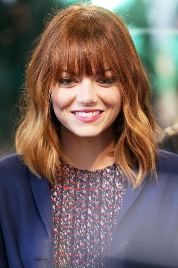 Emma Stone Medium Hairstyle with Blunt Bangs Getty Images