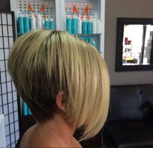 Short Bob Haircut with Long Side Bangs