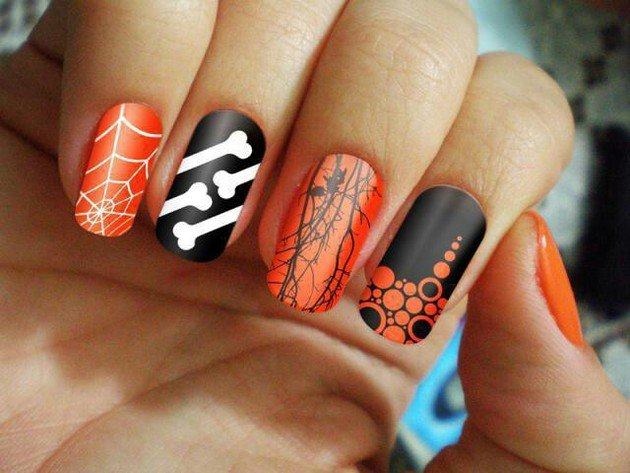 black and orange halloween nail design