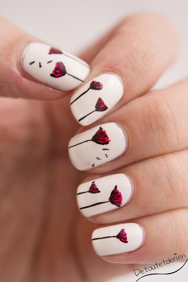 White and Red Dandilion Nail Design