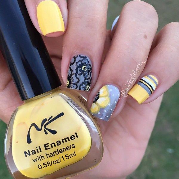 Gelbes und graues Nagel-Design