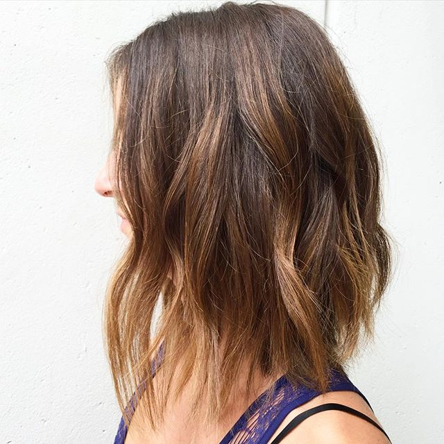Medium length bob hairstyle with caramel balayage highlights