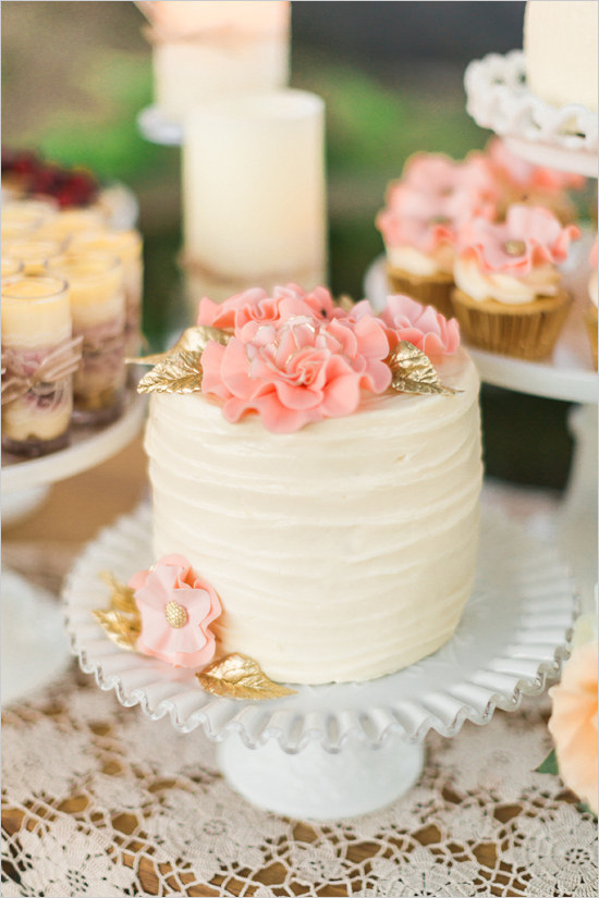 Wedding Cake with Pink Flowers and Gold Leaves