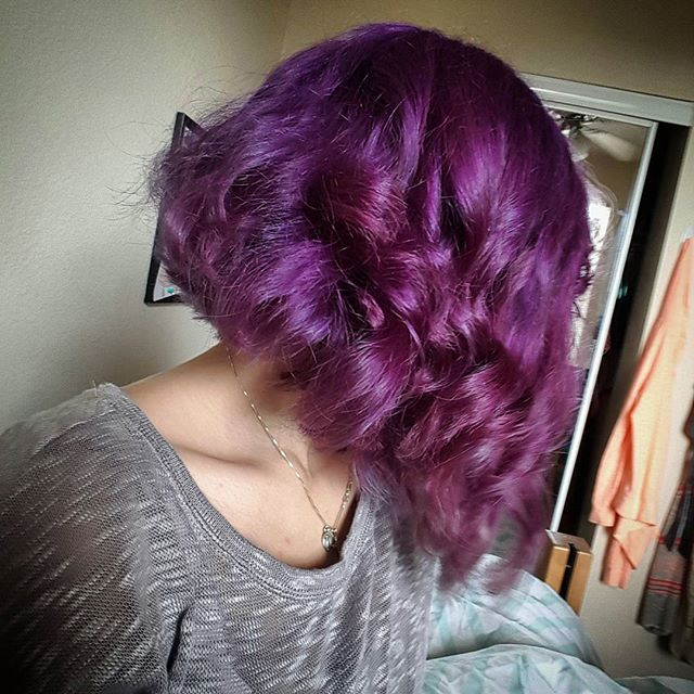 inverted wavy curly purple bob hairstyle