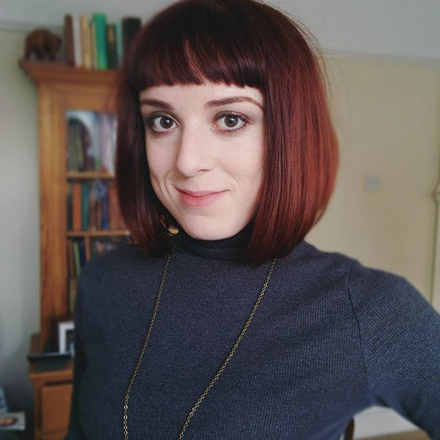 short red blunt bob haircut with blunt bangs