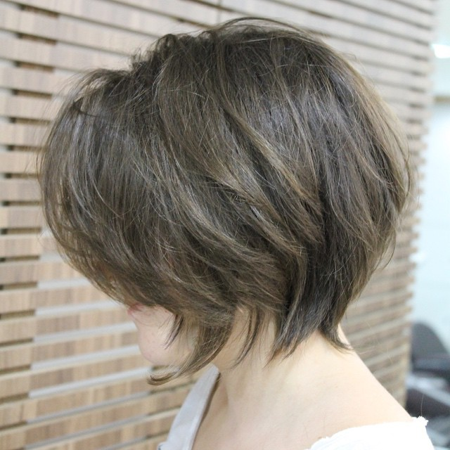 side view of cute layered messy bob haircut