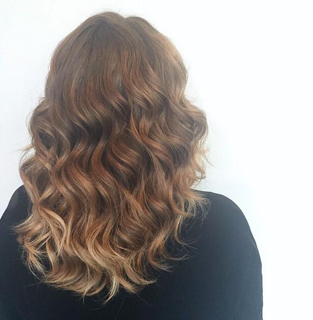 sun kissed permed hairstyle for medium length hair
