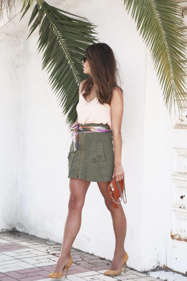 Light Top and Green Mini Skirt via