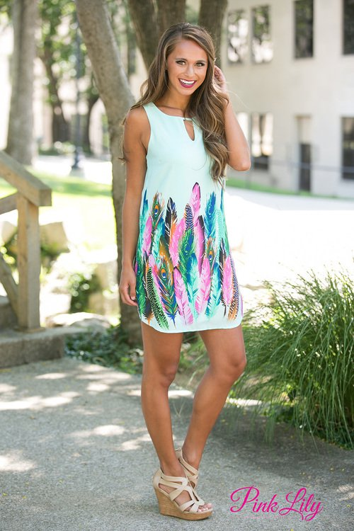 Pale Blue Dress with Colorful Feathers via