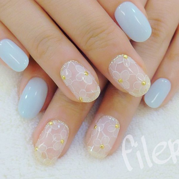 Pale Blue Nails with White Flowers via