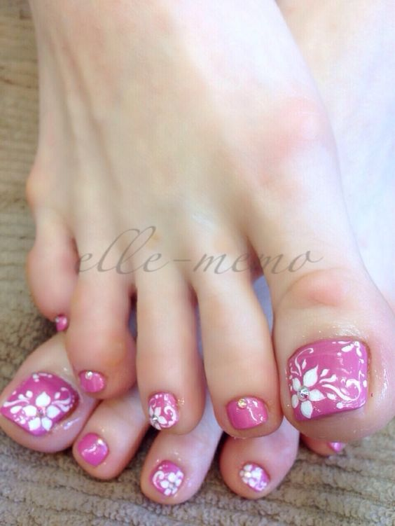 Pink Toe Nails with White Flowers via