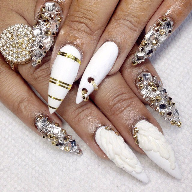 White Nails with Rings and Gems via