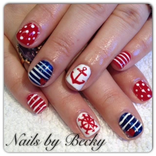Anchor and Rubber Nails via - 20 Nautical Themed Nail Arts You Will Like - Pretty Designs