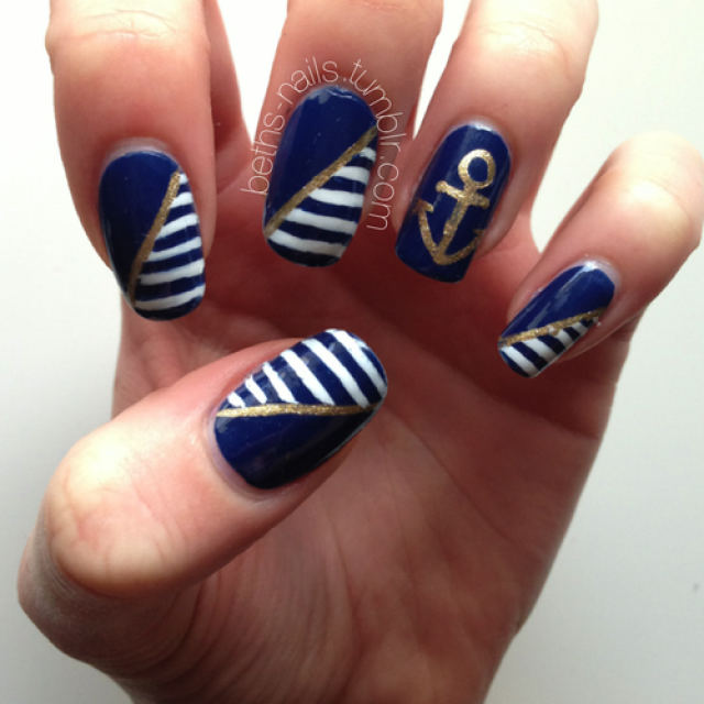 Blue, White and Golden Nails via - 20 Nautical Themed Nail Arts You Will Like - Pretty Designs