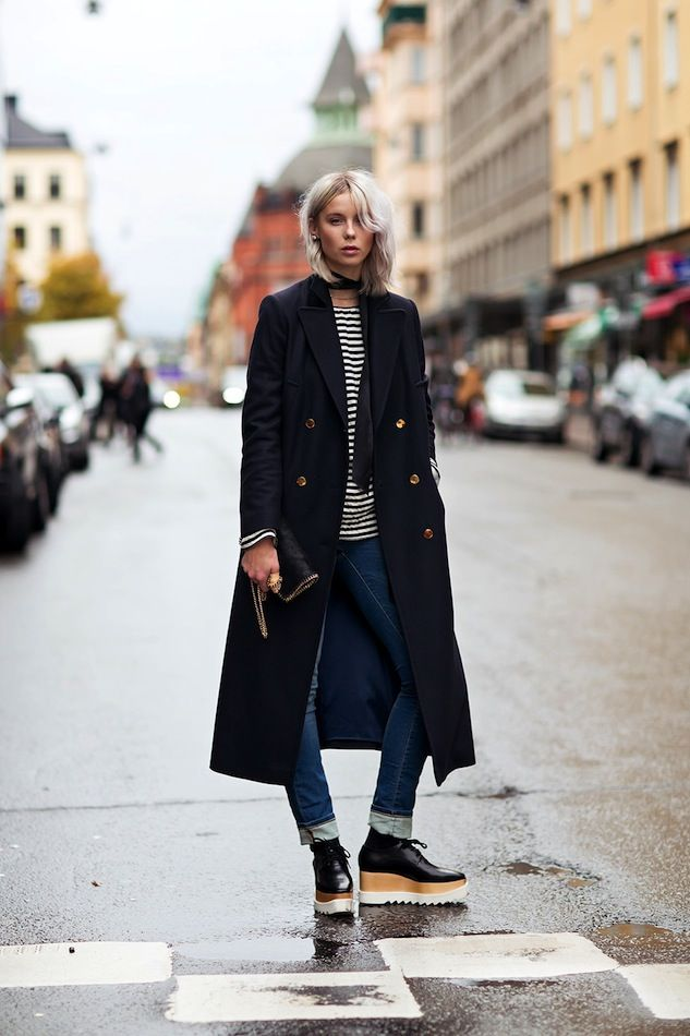 Striped Top, Jeans and Black Trench Coat via