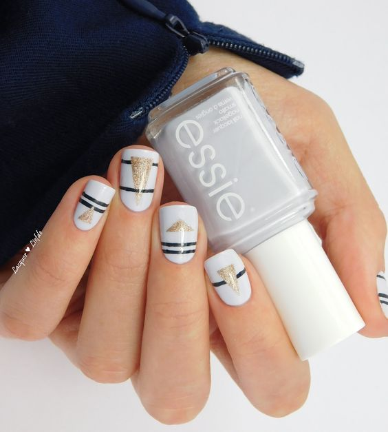 White Nails with Black Strips and Glitter Triangles via